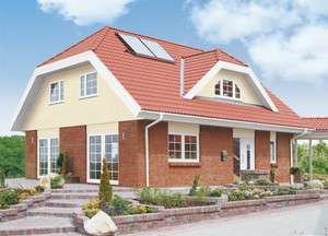 Haus mit Krüppelwalmdach und Klinkerfassade