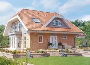 Haus mit Krüppelwalmdach und moderner Klinkerfassade